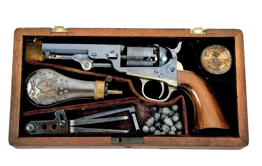This exquisite cased set not only shows what a brand new, mid-19th century 1849 Pocket Colt looked like with its lustrous blue and color case hardened finish, it also reveals the paraphernalia required to keep one of these caplock five shooters firing. The case includes a powder flask, percussion cap tin, lead projectiles (round ball and conical bullets), bullet mould and combination screwdriver and nipple wrench.– Courtesy Little John's Auction Service / Anaheim, California –