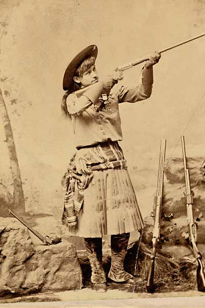 A major attraction at the Paris premiere, Annie Oakley took aim in this studio photograph, possibly photographed in 1886 or 1887, before the trips to London and Paris.