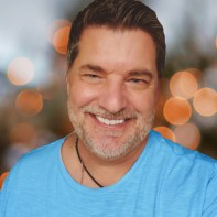 personal branding ted fauster smiling in a bright blue shirt