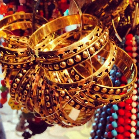 In addition to tiny statues of Hindu gods, wedding bangles are a hot selling among the street merchants.