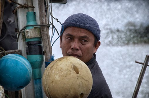 Manit Hankla's job as captain is to find the prime fishing spots and maneuver the boat so that his sons and brother can lay out the massive nylon nets.