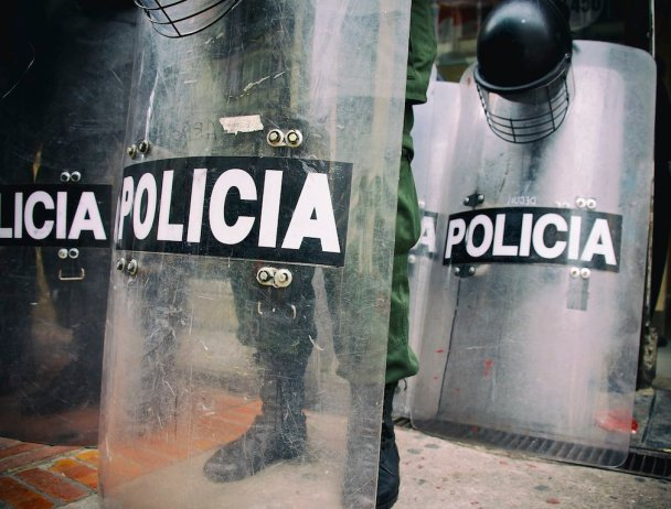 Police shields and their wielders stand ready on Ave Septima in Bogotá. Crowds protesting the removal of Bogotá mayor Gustavo Petro, who was ousted by Colombia's Inspector General in December last year, were streaming into the Plaza de Simon de Bolivar on Jan 10, 2014 to protest his removal. The dismissal of Petro has polarized Colombia and caused those on the political left to express fears for the future of democracy in the Andean nation.