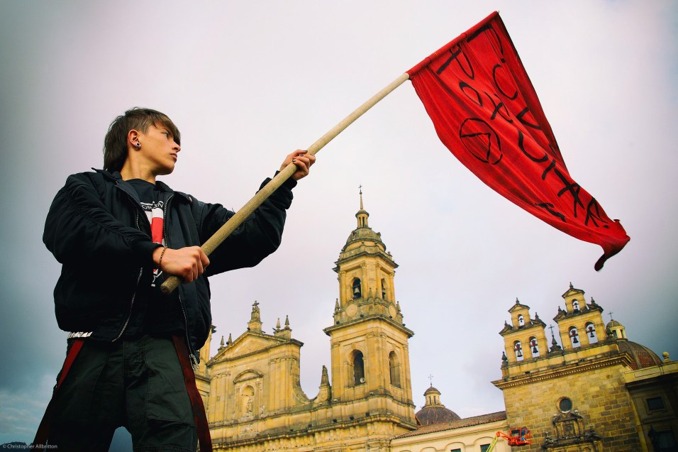 On Jan. 10, 2014, Juan David Fernandez, 16, of Bogotá, protests against the removal of Bogotá Mayor Gustavo Petro, who was ousted by Colombia's Inspector General in December last year. The dismissal of Petro has polarize Colombia and caused those on the political left to express fears for the future of democracy in the Andean nation.
