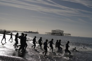 Triathlon entrants run into the sea in Brighton