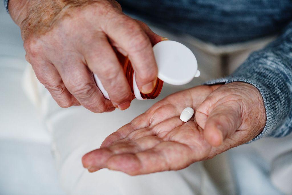 Person taking prescription medications