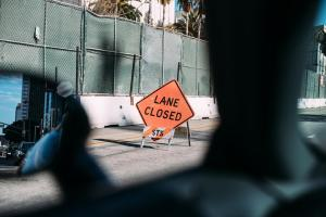 A lane closed sign shows there's a roadblock ahead