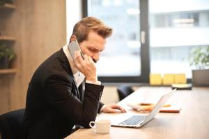 Frustrated business owner calling someone to discuss their company's growth