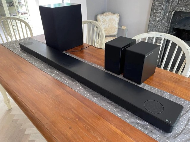 All four components of the LG SP11RA soundbar package.