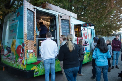 Students lining up for food trucks