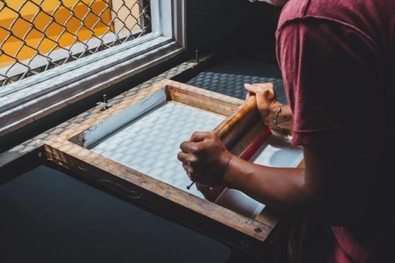man doing screen printing
