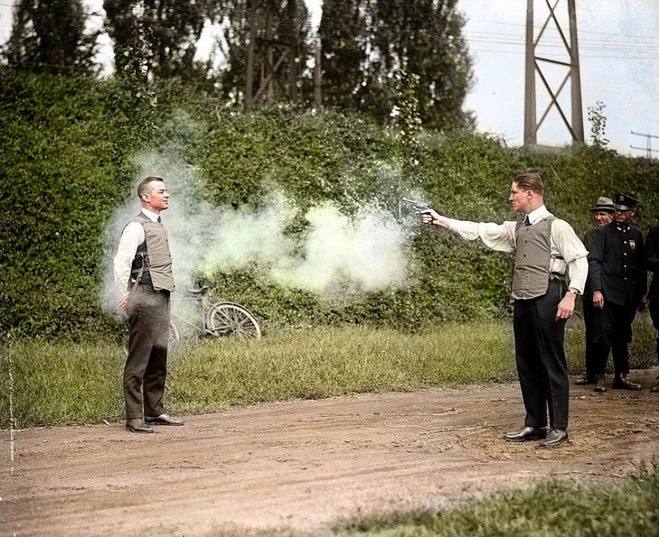W.H. Murphy and his assistant make demonstration of their bulletproof vest, 13 October 1923.