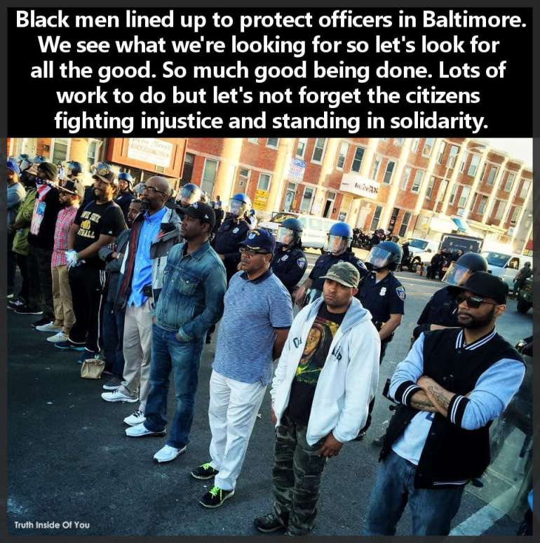 Black men lined up to protect officers in Baltimore.