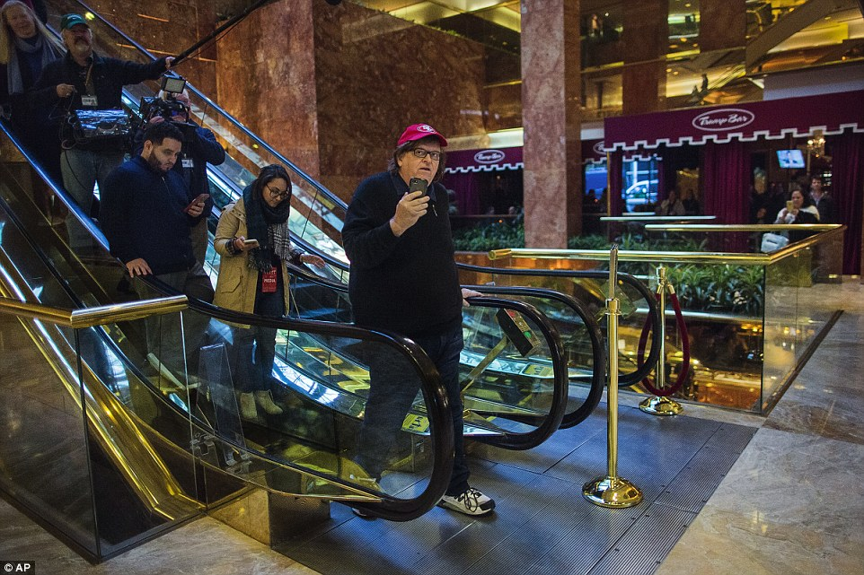 Filmmaker Michael Moore walks inside Trump Tower in New York on Saturday, Nov. 12, 2016