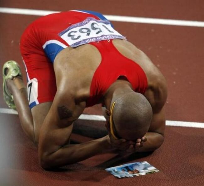 13. This athlete promised his granny that he would win the gold at the Olympics. This photo is after his win.