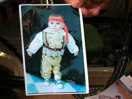Proud Parents Dress Baby As Suicide Bomber. Click For More Info.