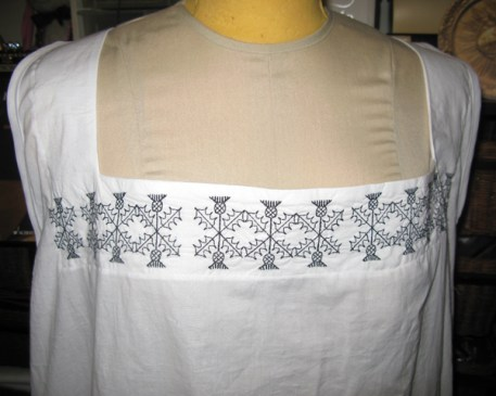 Neckline of English smock with machine-made blackwork