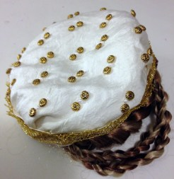 Beaded silk cap (& hair braids), worn with Venetian gown