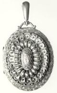 """Pendant inscribed """"Charlotte Brontë"""" on the back, image from The Brontë Society Collections"""