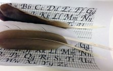 Quills with calligraphy guide.
