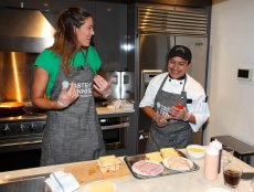 NEW YORK, NY - AUGUST 24: (L-R) Garbine Muguruza and Chef Arturo Vivanco cook together during The Taste Of Tennis Master Class With St Giles Hotels at The Tuscany, A St Giles Signature Hotel on August 24, 2016 in New York City. (Photo by Donald Bowers/Getty Images for St Giles Hotels)