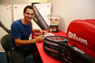 MELBOURNE, AUSTRALIA - JANUARY 30: Roger Federer of Switzerland is presented with a commemorative 18 Grand Slam Tennis Racket after winning the 2017 Mens Australian Open Championship at Melbourne Park on January 30, 2017 in Melbourne, Australia. (Photo by Clive Brunskill/Getty Images for Wilson)