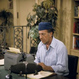 Oscar Madison from the Odd Couple typing