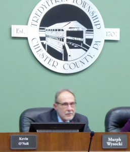 Murph Wysocki under the Tredyffrin Township Seal after being elected Chair of the Board of Supervisors