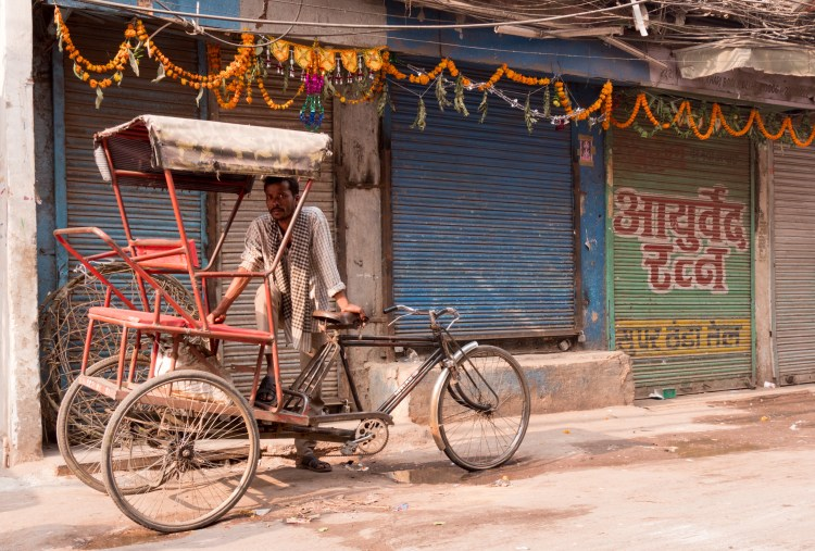 Man Standing with His Rickshaw at Spice Market - Old Delhi, India - Copyright 2016 Ralph Velasco