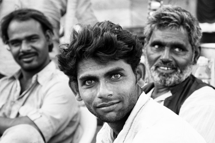 Man with Piercing Eyes and Two Friends in Black and White - Pushkar, India - Copyright 2016 Ralph Velasco