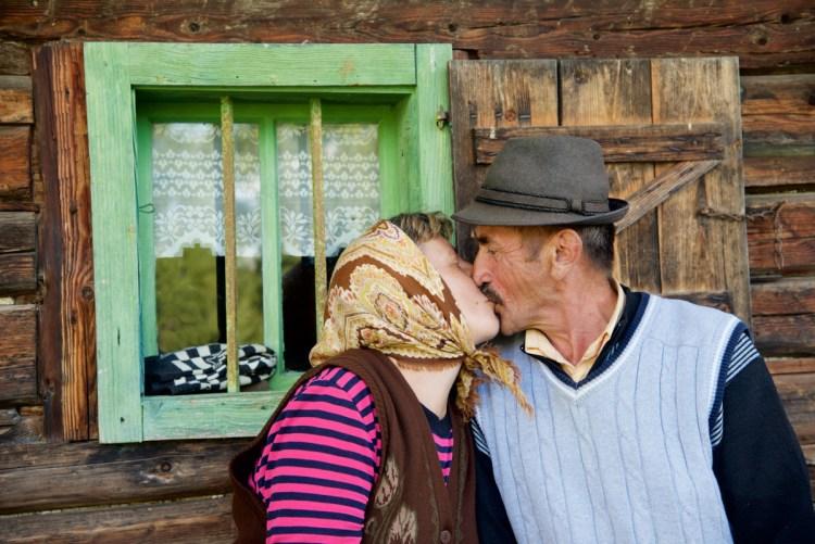 Ileana and Dinu Kissing at Sheepfold - Jina, Romania - Copyright 2015 Ralph Velasco