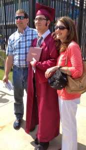 My brother and my parents outside of Reliant Stadium in Houston after his graduation.