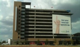 "The south side of the RaiderPark parking garage, displaying the current Suddenlink Communications ""wallscape"" advertisement"