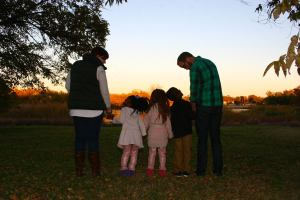 Keene pictured with his wife and his 3 nearly adopted children. Photo source: Justin Keene