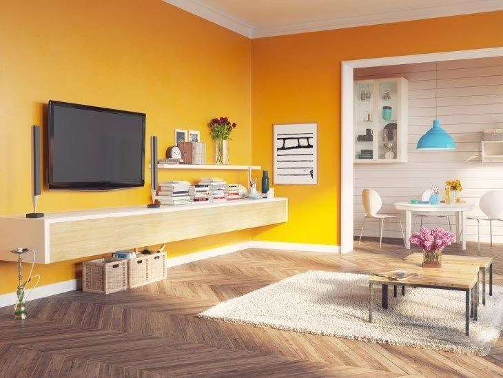 Parede amarela veja dicas para decorar espaos usando