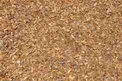 playground surface is primarily mulch with some soft rubber