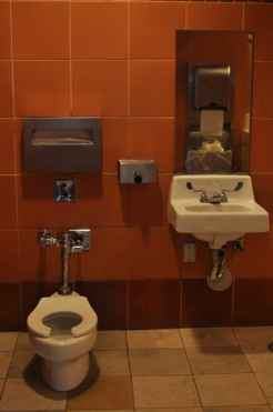 miniature toilet and sink in Park Place Family Restrooms