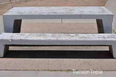 unshaded and dilapidated tables at Himmel Park