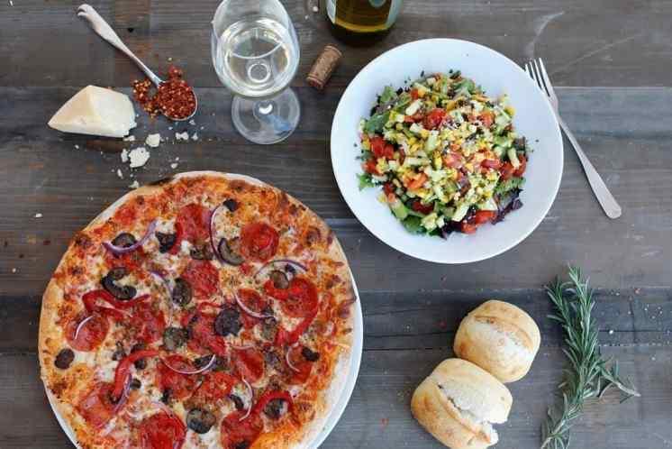 Suprema Pizza and Vegetable Salad at Sauce