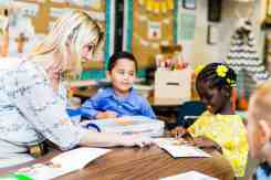 teacher reading Casas Christian School