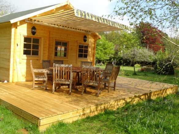 Decking area in front of the log cabin