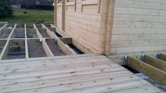Decking boards being laid outside the Edelweiss log cabin