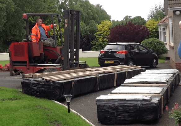 Delivery of our log cabins using a Moffett Fork lift
