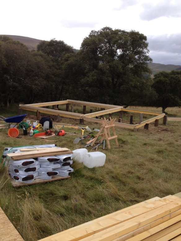 The perfect way of building a timber frame base. The first foundation logs have been added.