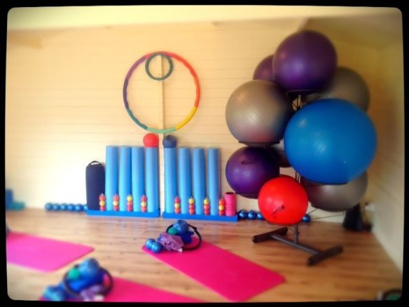 One of our log cabins being used as a pilates class room