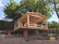 A very impressive fit in a difficult location using a timber frame base of brick piers.