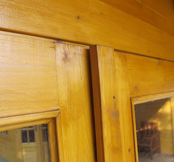 Warp in the log cabin door is identified and needs correcting.