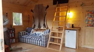 An Inside View Of The Berlin Log Cabin