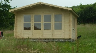A Far View Of The Blackpool Log Cabin
