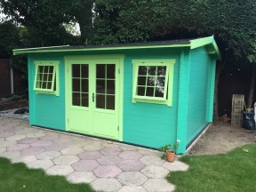 The Fully Painted Jenny Log Cabin