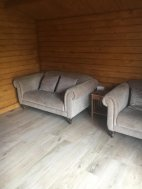 Sofas inside the Ulrik Log Cabin